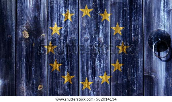 Flag of the European Union painted on an old wooden door