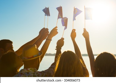 Flag of of the European Union. People waving flags of the European Union. Crowd support Europe. Fans waving flags of the European Union.