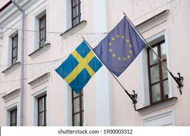 The flag of the European Union and Sweden on the wall of the embassy building.