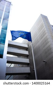 Flag of the European Union waving in front of an ambassy building in Berlin, Germany.