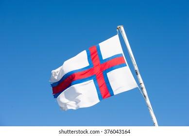 Flag of the Faroe Islands on a white flag pole
