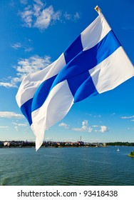 Flag of Finland against Helsinki skyline