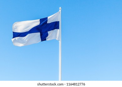 Flag of Finland or Blue Cross Flag over blue sky background