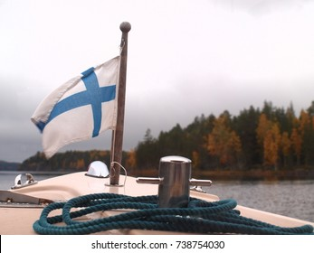 Flag Finland on a boat in a Finnish Natural Park.