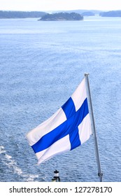 Flag of Finland on cruise ship on Baltic Sea.