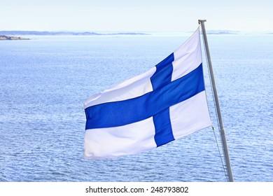 Flag of Finland on cruise ship in Aland Islands archipelago.