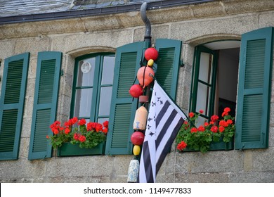Flag and flowers in harbor town