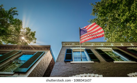 A flag flying on a sunny morning from a building in Alexandria, Virginia.
