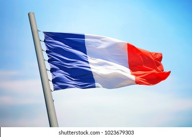 Flag of France against the background of the blue sky