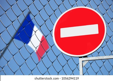 flag of France behind the fence with the sign of entry is forbidden