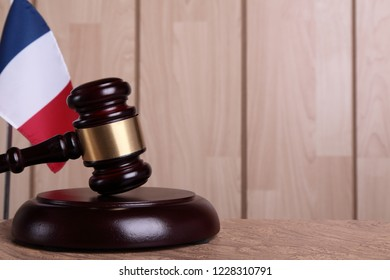 Flag of France and a gavel on a sounding block