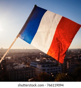 The Flag of France on background of the  view of Paris from Sacre Coeur Basilica in France in  sunset tima
