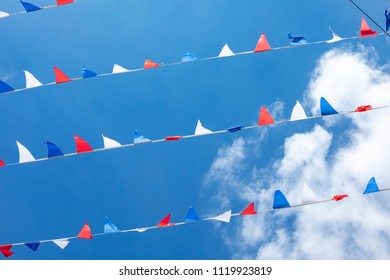 flag of France it is a tricolor flag colored blue white and red on blue sky background