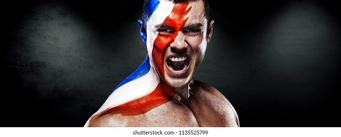 Flag of France - winner and champion soccer or football fan with bodyart on face.