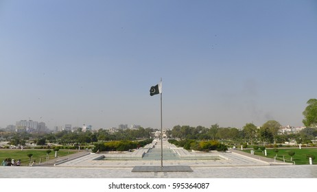 Flag in front of Mazar-e-Quaid - mausoleum of the founder of Pakistan, Muhammad Ali Jinnah. Iconic symbol of Karachi in Pakistan