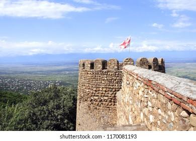 Flag of Georgia on the medieval fortress wall, Sighnaghi (Signagi city), easternmost region of Kakheti, Georgia