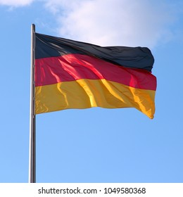 Flag of Germany - national symbol in the wind.