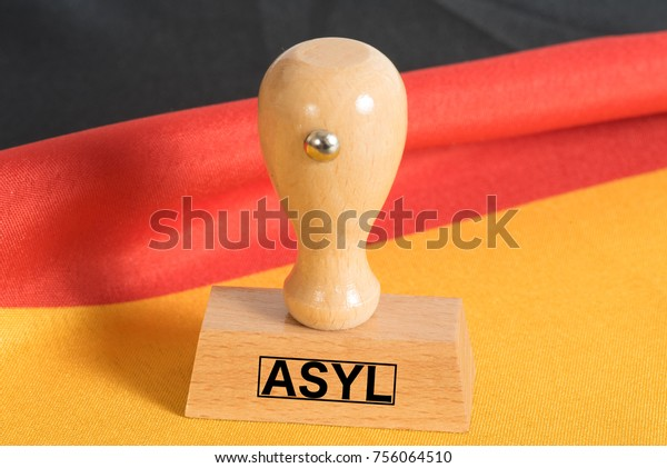 Flag of Germany and a stamp with the german word for asylum