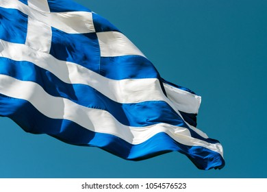 Flag of Greece against the blue sky background