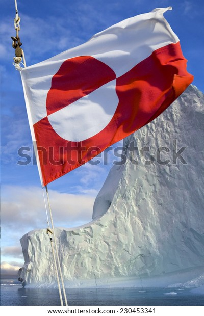 Flag of Greenland - Adopted 21st June 1985. The flag of Greenland is the only national flag of a Nordic country or territory without a Nordic Cross. Photographed in Scoresbysund, eastern Greenland.