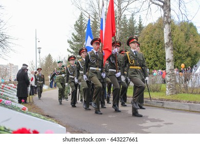 A flag group with flags on the track. Kirishi, Russia - 9 May, 2017. Laying wreaths and flowers in memory of the fallen at the Eternal Flame.