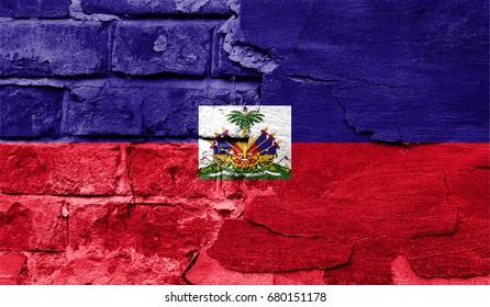 Flag of Haiti against a brick wall.