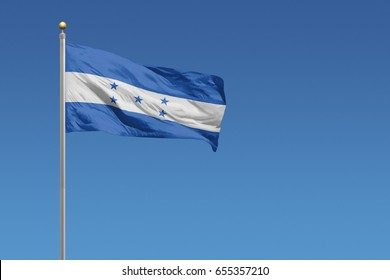 Flag of Honduras in front of a clear blue sky