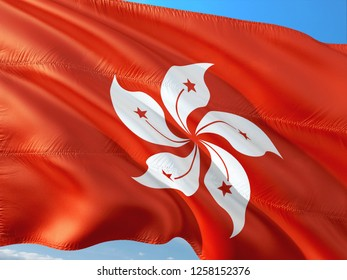 Flag of Honk Kong waving in the wind against deep blue sky. High quality fabric.