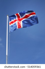 The flag of Iceland on blue sky.