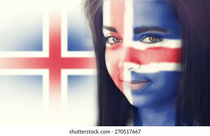 The flag of Iceland on the face of a smiling woman. / Color effects and custom white balance is added to this photo.
