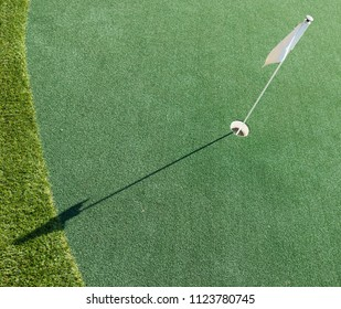 A flag indicating where the hole is in the sport of Golf.
