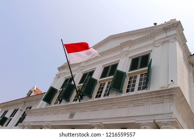 The flag of Indonesia flying at Governor Office (Gouverneurskantoor) now Museum Fatahillah in Kota Tua Old Town. Taken in Jakarta, October 2018.