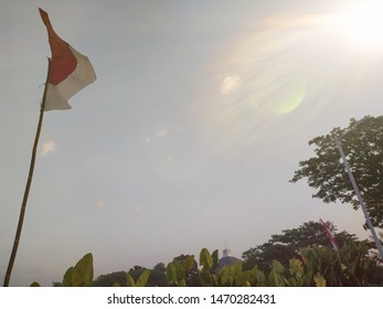 Flag of Indonesia hanging down dangling with light flare