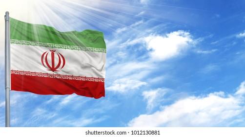 Flag of Iran on flagpole against the blue sky