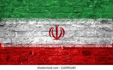 Flag of Iran over an old brick wall background, surface.