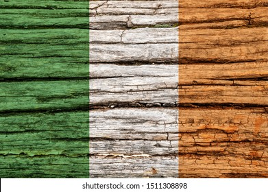 Flag of Ireland on an old wooden surface. Textured wallpaper background for creativity and design.