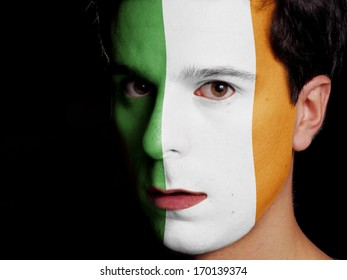 Flag of Ireland Painted on a Face of a Young Man