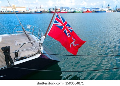 Flag of Isle of Man at the stern of a luxury yacht.