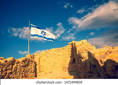 Flag of Israel against the morning sky. Flag of Israel on Masada fortress