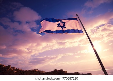 Flag of Israel against the morning sky