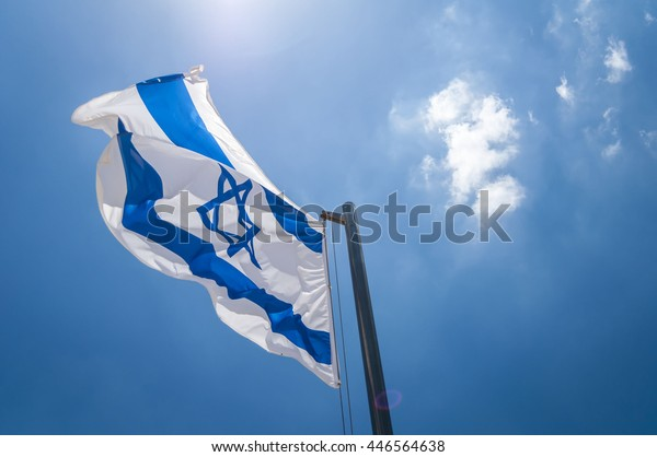 The flag of Israel in the blue sky stock image. Yom Haatzmaut, Israel Independence Day, Independence Day Israel, Yom Hazikaron, Holocaust Remembrance Day, Herzl Mount, Jerusalem, Israel. June 2016.