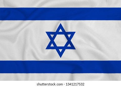 Flag of the Israel from the factory knitted fabric. Backgrounds and Textures.