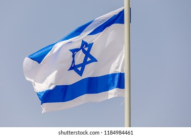 Flag of Israel at morning sky background