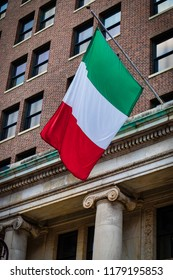The flag of Italy blowing in the wind on a Philadelphia street.
