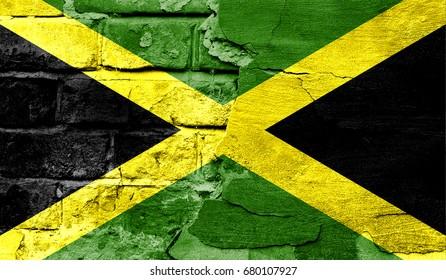 Flag of Jamaica against a brick wall.