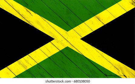 Flag of Jamaica on a wooden background.