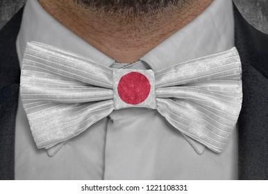 Flag of Japan on bowtie business man suit