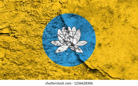 Flag of Kalmykia close up painted on a cracked wall, concept of armed actions and conflicts in the world