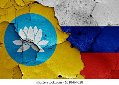 flag of Kalmykia and Russia painted on cracked wall