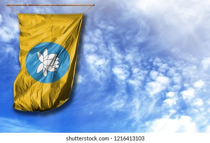 Flag of Kalmykia. Vertical flag, against blue sky with place for your text